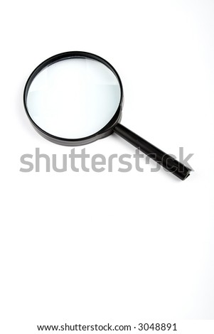 Magnifying glass, isolated on white - stock photo