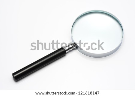 Magnifying glass isolated on white background, close-up - stock photo