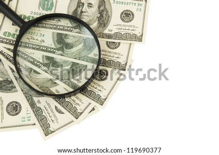 Magnifying glass on dollars isolated on white - stock photo