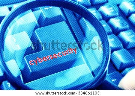 Magnifying glass on keyboard with Cybersecurity word on button. Color halftone effect applied. - stock photo
