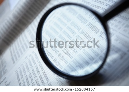 Magnifying glass on the document - stock photo