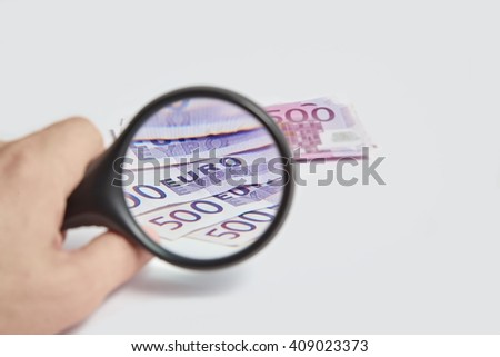 Magnifying Glass on the five hundred bill Euros - stock photo