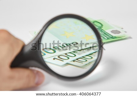 Magnifying Glass on the one hundred Euros - stock photo