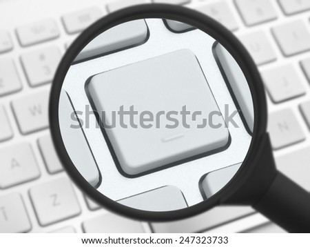 Magnifying glass over a computer keyboard - stock photo