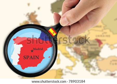 Magnifying glass over a map of Spain - stock photo