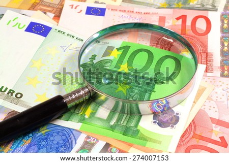 Magnifying glass over Euros. Perfect for any financial, commerce, treasury or banking needs.  - stock photo