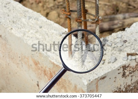 magnifying glass over The concrete pile at the construction site - stock photo