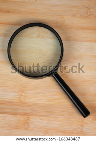 magnifying glass over the table - stock photo