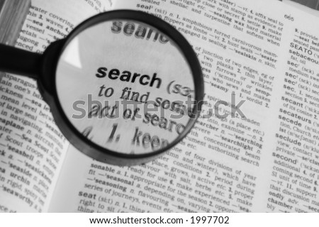 """Magnifying glass over the word """"search"""" - stock photo"""