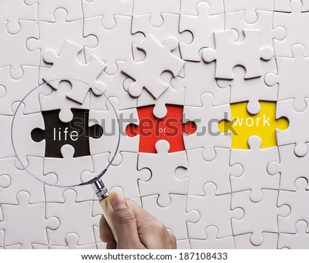 "Magnifying glass searching missing puzzle peace "" LIFE"" - stock photo"