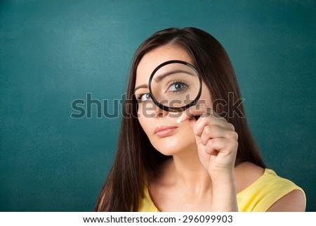 Magnifying Glass, Searching, Women. - stock photo