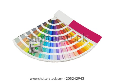 Magnifying glass standing on pantone palette on a white background - stock photo