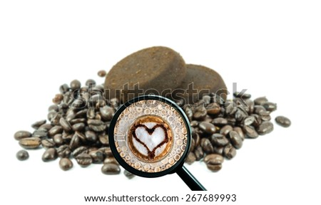 magnifying glass with background of roasted coffee beans to be coffee cup with heart shape, food and drink with business concept - stock photo