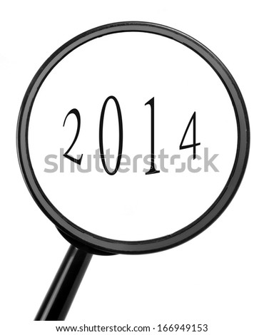 magnifying glass with the new year - stock photo