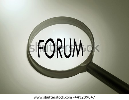 Magnifying glass with the word forum. Searching forum - stock photo