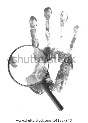 Magnifying lens and black hand print on white background - stock photo