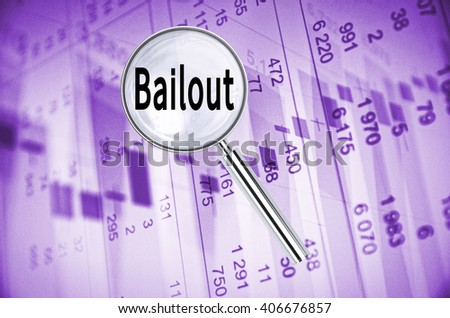 Magnifying lens over background with text Bailout, with the financial data visible in the background. - stock photo
