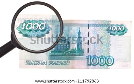 magnifying loupe enlarge banknote isolated on white background - stock photo