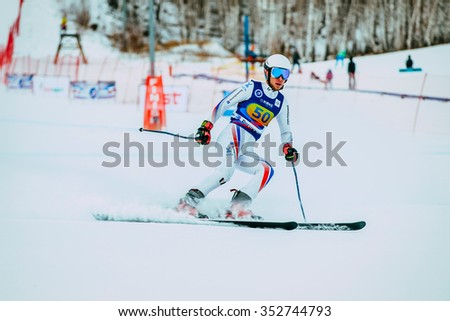 Magnitogorsk, Russia -  December 13, 2015: young man skier after finish spray of snow during Russian Cup in alpine skiing - stock photo