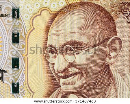 Mahatma Gandhi face on indian 500 rupee banknote macro, India money closeup - stock photo
