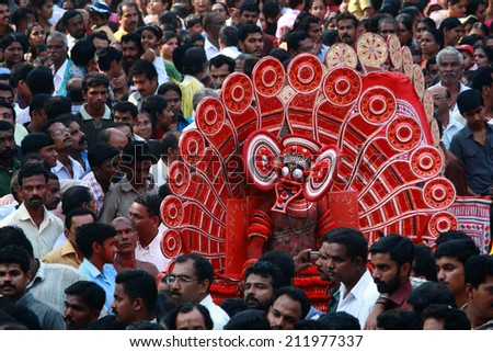 MAHE, INDIA - JANUARY 31 : An unidentified Theyyam artist performs during the annual festival at Palloor temple on January 31, 2010 in Mahe, India. Theyyam is a ritualistic folk art form of Kerala. - stock photo