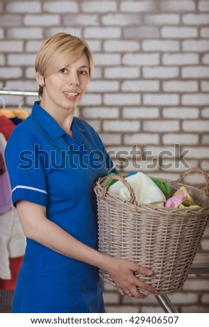 maid with of laundry basket - stock photo