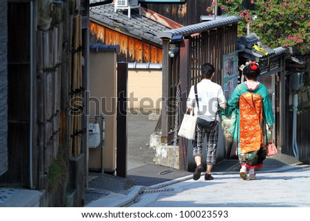 Maiko walking on a street (Kyoto, Japan) - stock photo