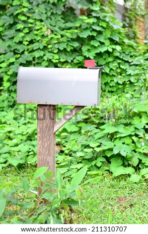 Mail Box in Front of a House  - stock photo