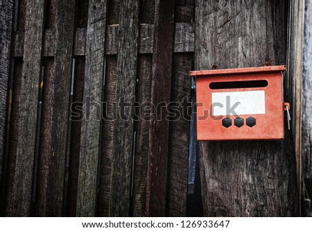 Mail Box on the old wooden wall - stock photo