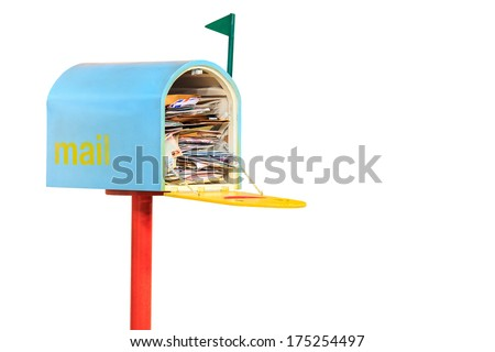 Mail box overflowing with mail - stock photo