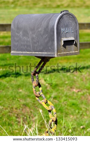 Mail Box supported by chains in the nature - stock photo