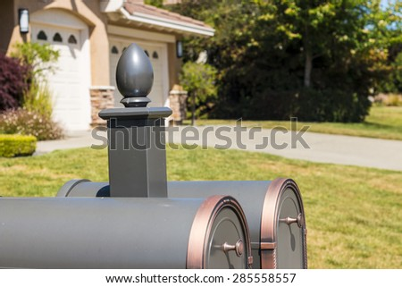 Mail boxes in front of suburb house. Selective focus - stock photo