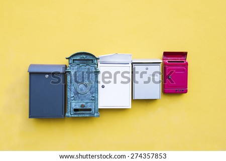 Mail boxes on a yellow wall - stock photo