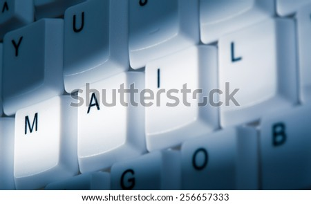 mail concept image on computer keyboard with lightray - stock photo