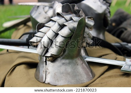 Mail medieval gloves lie on the ground - stock photo