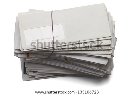 Mail stacked high of unpaid bills isolated on a white background. - stock photo