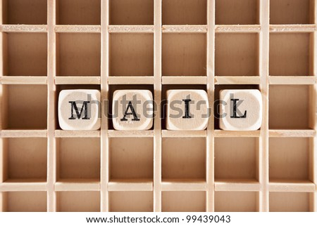 Mail word construction with letter blocks / cubes and a shallow depth of field - stock photo