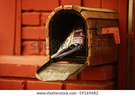 Mailbox and a Red Brick House - stock photo