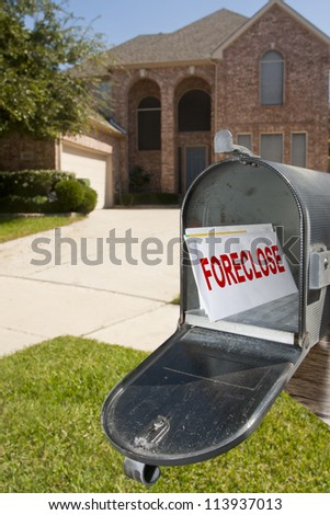 Mailbox filled with monthly bills and notices - stock photo
