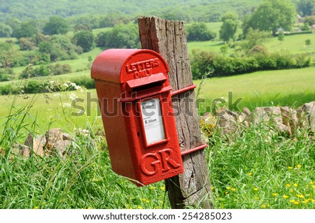 Mailbox in English countryside of Cotswolds - stock photo