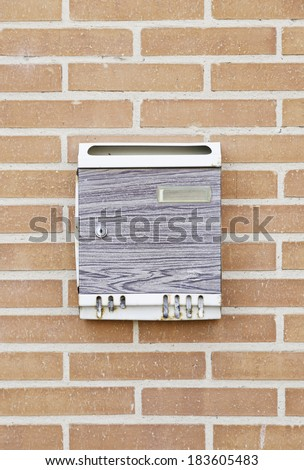 Mailbox in the wall, detail of an object to cast cards - stock photo