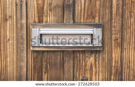 mailbox on wood wall background - stock photo