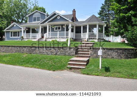 Mailbox Steps leading to Suburban Home on sunny blue sky day - stock photo