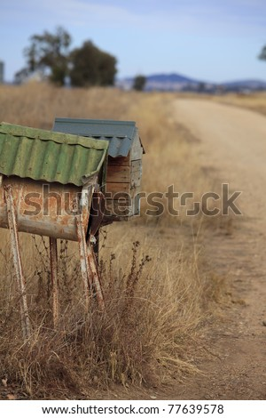 Mailboxes beside a country road - stock photo