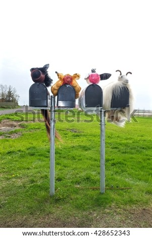 Mailboxes with stuffed animals and beautiful landscape  - stock photo