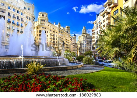 Main city square of Valencia, The Plaza del Ayuntamiento in bright afternoon colors, Spain - stock photo