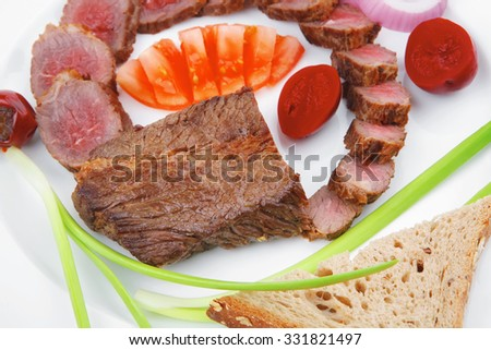 main course : roast red meat slices served on white plate with tomatoes , sprouts and bread  isolated on white background - stock photo