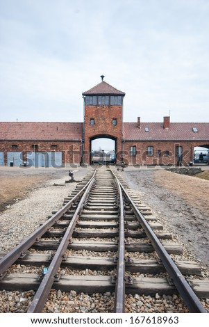 Main entrance to Auschwitz Birkenau Concentration Camp - stock photo