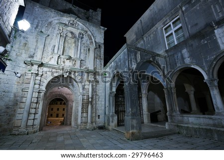 Main entrance to the old medieval town Korcula  by night. Croatia, Europe. - stock photo
