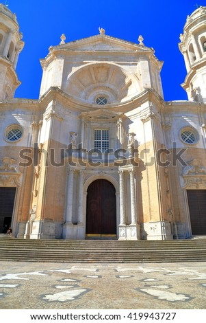 Main facade and entrance to the Baroque building of Cadiz Cathedral in Cadiz, Andalusia, Spain - stock photo